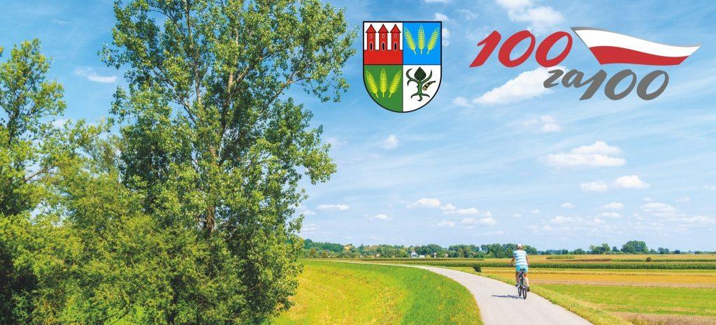 Baner ze zdjęciem mężczyzny jadącego na rowesze po drodze przez łąkę, w górze herb Przasnysza i logo projektu