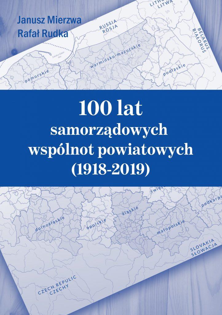 niebieska okładka z administracyjną mapą polski w tle, na środku pasek z tytułem