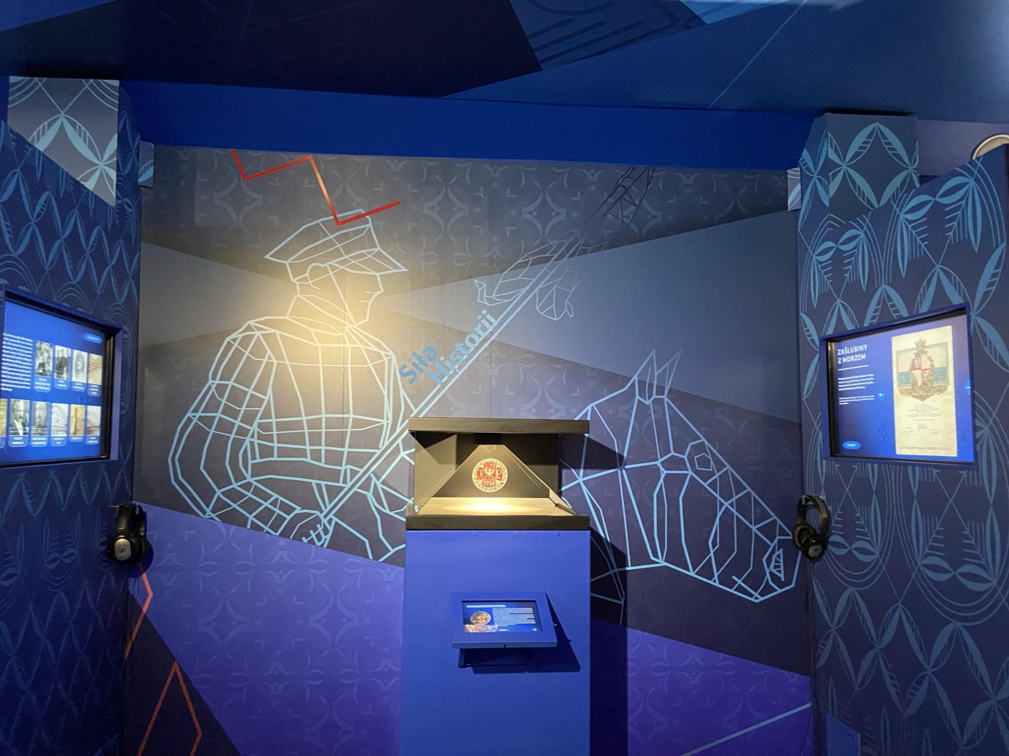 zdjęcie ukazujące elementy multimedialny i fragment dekoracji graficznej wnętrza tira